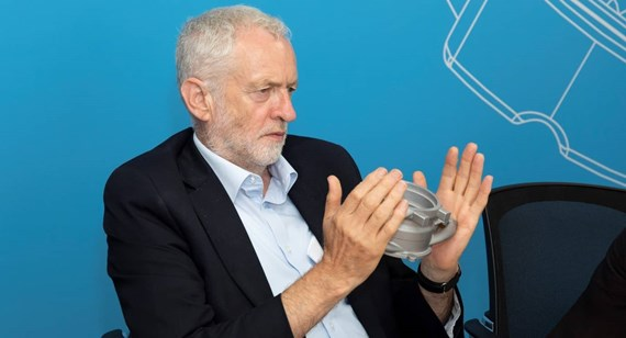 Jeremy Corbyn holds a 3D printed prototype at the Protolabs manufacturing facility in Telford (© Protolabs 2018)